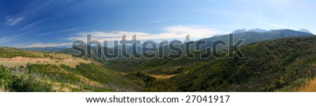 Panorama of the Rocky Mountains. Mountain range near Sundance, Utah.  Blue sky, mountains, and green vegetation - stock photo