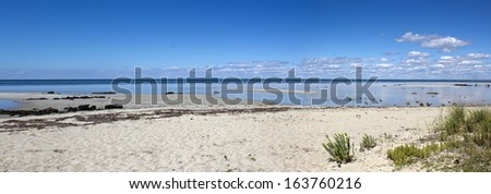 Panorama of the scenic view of the idyllic coastline at peaceful  Dunsborough in   Geographe Bay   south western Australia on a fine afternoon in  spring. - stock photo
