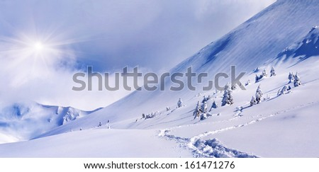 Panorama of the snowy mountain. Snowstorm - stock photo