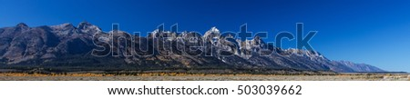 Panorama of the Tetons in autumn in Wyoming USA.