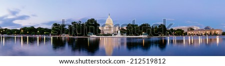 Panorama of the United Statues Capitol, seen from the the Capitol Reflecting Pool, Washington DC, USA. - stock photo
