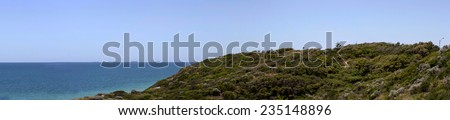 Panorama of the  vegetated dunes and Indian Ocean at Dallyellup Beach near Bunbury south western Australia on a sunny afternoon in early summer  is cool and inviting. - stock photo