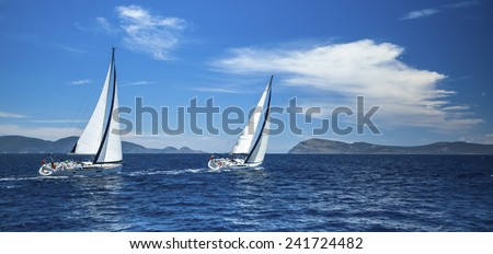 Panorama of the yacht race in the open sea. Sailing. Luxury yachts. - stock photo