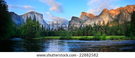 Panorama of the Yosemite Valley (El Capitan, Cathedral Rocks, Bridalveil Falls) at the Merced River. - stock photo