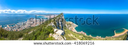 Panorama of top of Gibraltar Rock, in Upper Rock Natural Reserve: on the left Gibraltar town and bay, La Linea town in Spain at the far end, Mediterranean Sea on the right. United Kingdom, Europe. - stock photo