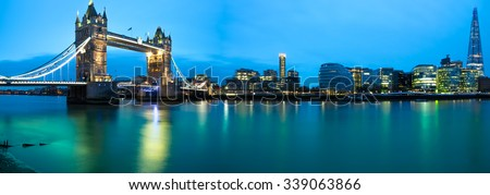 Panorama of Tower Bridge,Thames river, Shard hotel and City Hall at sunrise in London viewed from Tower of London. England - stock photo