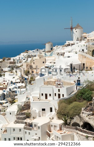 Panorama of traditional terraced houses in Oia, Santorini - stock photo