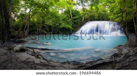 Panorama of tropical forest, waterfall and small pond in Thailand. Scenic nature background - stock photo