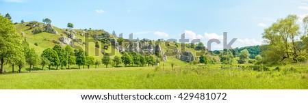 Panorama of valley Eselsburger Tal near river Brenz - jewel of the swabian alps (Schwaebische Alb), green meadow / grassland in front - stock photo