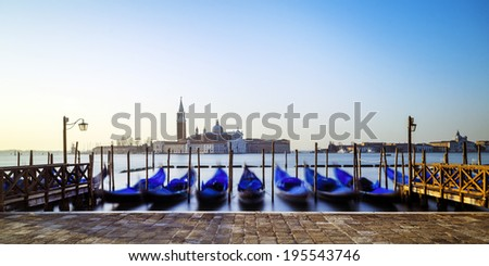 Panorama of venetian gondolas - stock photo
