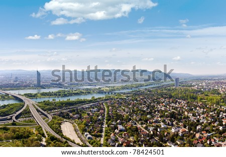 Panorama of Vienna / Danube River / Brigittenauer Bridge / highway (no. A22) junction and one of the most interesting extensive public recreation area of Vienna called Danube Island (Donauinsel).