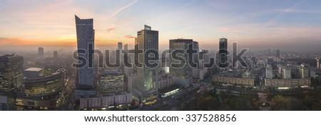 Panorama of Warsaw city during autumn sundown - stock photo