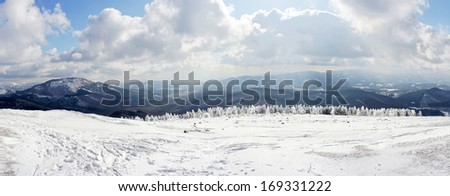 panorama of winter and snowy landscape in mountain - stock photo