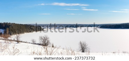 Panorama of winter lake on a sunny day - stock photo