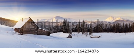 Panorama of winter mountains with houses of shepherds. Carpathians, Ukraine, Europe - stock photo