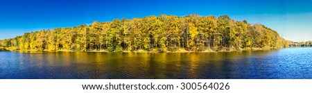 Panorama of wonderful autumn pond. - stock photo