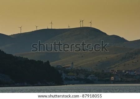 Panorama of Zaboric and wind turbines on the mountain - stock photo