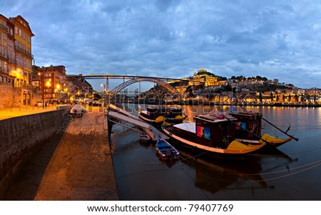 panorama old Porto river Duoro, vintage port transporting boats, old town, town of Gaia and famous bridge Ponte dom Luis, Portugal - stock photo
