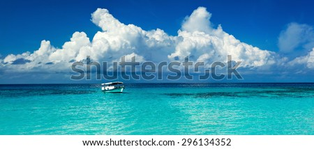 panorama oldest boat of in the tropical lagoon turquoise Caribbean Sea in the Maldivian Hawaiian Bahamas - stock photo
