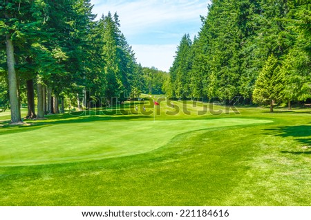 Panorama, outlook at the beautiful golf course  in a sunny day. Canada, Vancouver. - stock photo