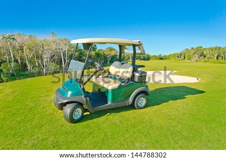 Panorama, outlook at the beautiful golf course with the golf cart . Mexican resort.