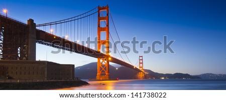 Panorama photo of Golden Gate Bridge at night time, San Francisco, USA - stock photo