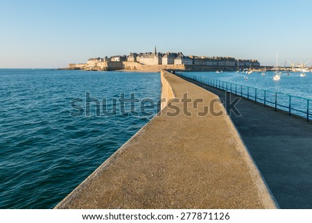 Panorama Seaside View over the walled city Saint-Malo medieval pirate fortress and St Vincent Cathedral in Summer Daytime, Brittany, France from lighthouse - stock photo