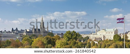 Panorama view from the public Volksgarten park (English: People's Garden) at the the Town Hall, Imperial Court Theater, and part of the Austrian Parliament Building.In the Background the Kahlenberg. - stock photo