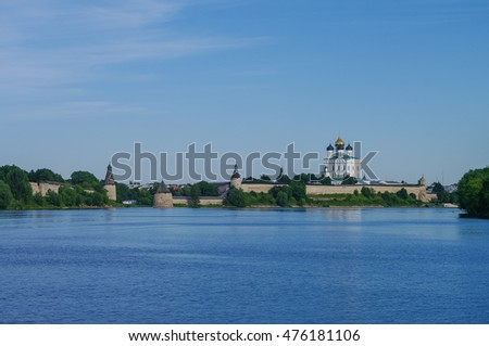 Panorama view from Volhov river of Trinity Cathedral, the bell tower and the walls and tower of Pskov Kremlin. Pskov, Russia