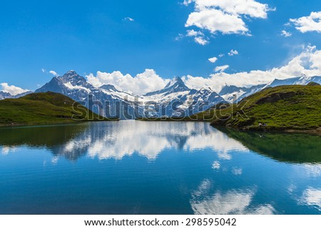Panorama view of Bachalpsee and the snow coverd peaks with glacier of swiss alps - stock photo