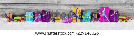 Panorama View of Beautiful Colored Gift Box Decorations on the Snow with Vintage Wooden Wall Behind. - stock photo