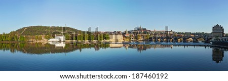 Panorama view of Charles bridge over Vltava river and Gradchany (Prague Castle) and St. Vitus Cathedral in the morning, Prague, Czech Republic - stock photo