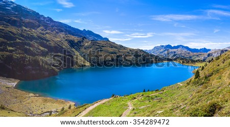 Panorama view of Engstlensee lake and the Alps on a sunny day on Bernese Oberland, Switzerland.