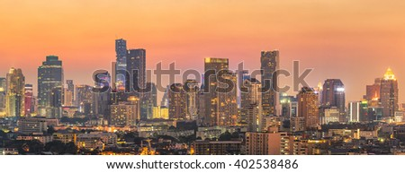 Panorama view of modern office buildings, condominium in big city downtown at sunset - stock photo