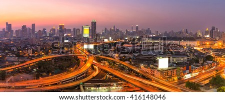 Panorama view of Modern office buildings, condominium in big city downtown with Motorway, Expressway, Freeway the infrastructure for transportation in modern city, urban view at twilight time - stock photo