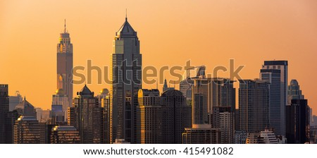 Panorama view of modern office buildings, condominium in big city downtown with sunset sky - stock photo