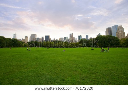 panorama view of New York City Central Park with Manhattan skyline and skyscrapers.