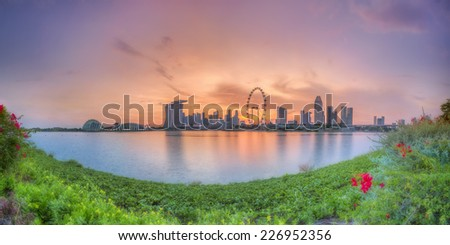 Panorama view of Singapore city skyline at sunset - stock photo