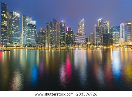 Panorama view of Singapore marina bay business center with water reflection