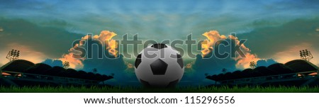 panorama view of sport stadium dusky time colorful sky with soccer football - stock photo