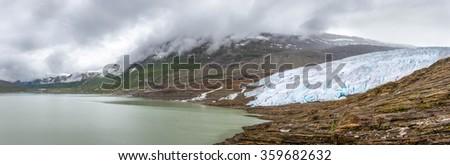 Panorama view of the glacier Svartisen in Norway - stock photo