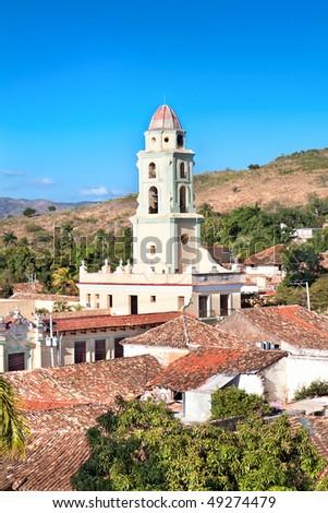 Panorama view on the bell tower of the Museum Nacional de la Lucha Contra Bandidos. It was Convento de San Francisco church before,  Trinidad, Cuba. - stock photo