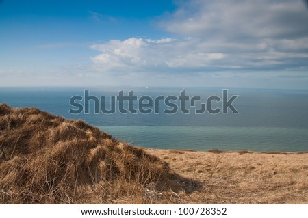 Panorama view on the cliffs of Dover, England from above the top of Cap Blanc Nez, near Calais, France - stock photo