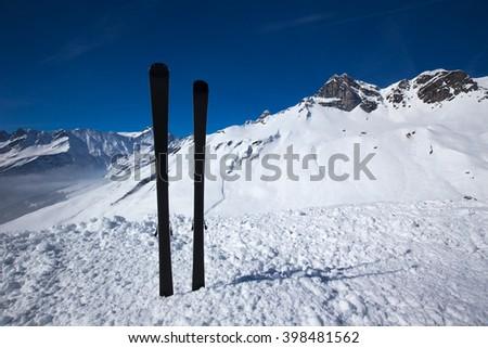 Panorama view to Swiss Alps, ski and chair lift in Elm ski resort, Switzerland. Elm is famous ski resort with 40 km prepared ski slopes, 4 km tobogganing slopes and children arena.  - stock photo