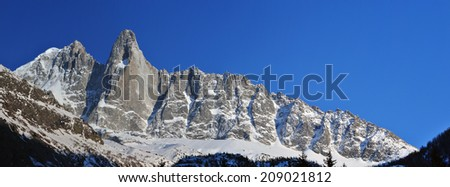 Panorama with Aiguille Verte and Aiguilles du Dru (or Les Drus) in the Mont Blanc Massif, Les Praz de Chamonix, France. - stock photo
