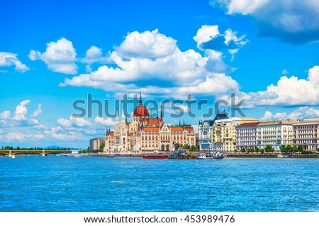 Panorama with building of hungarian parliament at danube river in budapest city hungary blue sky clouds - stock photo