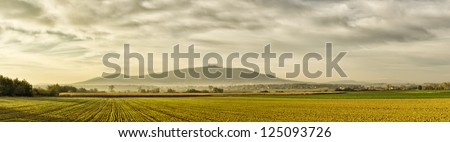 Panorama with field and famous Sleza Mountain, Poland - stock photo