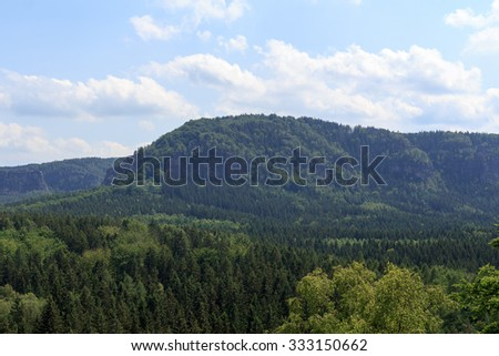 Panorama with mountain Kleiner Winterberg and forest seen from Kuhstall in Saxon Switzerland