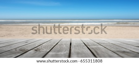 Panorama With Wooden Terrace On The Beach With Sea And Blue Sky For A  Summer Concept