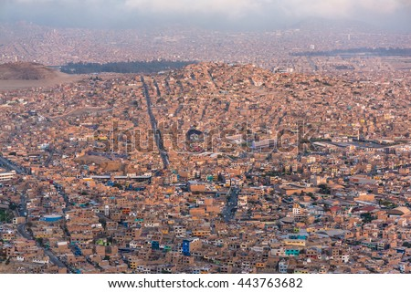 Panoramic aerial view of a poor town in Chorrillos, Lima. - stock photo